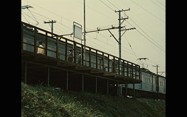 This train scene divides the film.