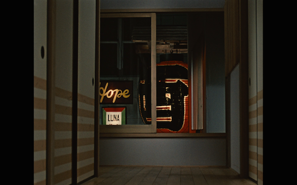 This transition shows an interior with signage in the exterior.